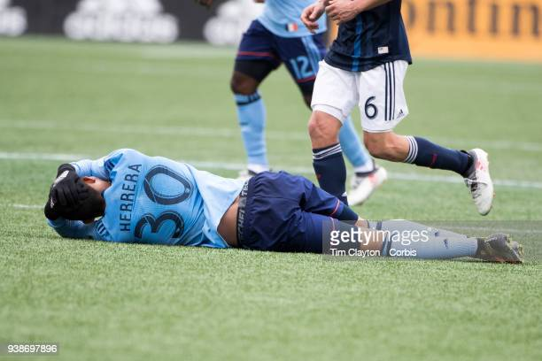 Yangel Herrera of New York City holds his head after a clash heads with Wilfried Zahibo of New England Revolution during the New England Revolution...
