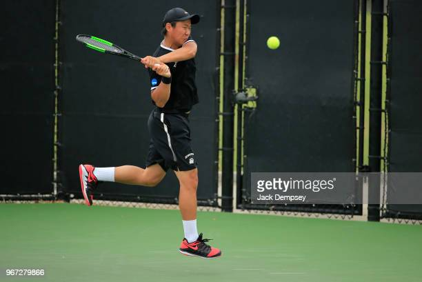 Yangeng Jiang of the Bowdoin Polar Bears hits a backhand against the Middlebury Panthers during the Division III Men's Tennis Championship held at...
