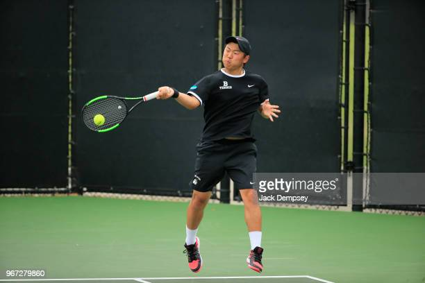 Yangeng Jiang of the Bowdoin Polar Bears hits a forehand against the Middlebury Panthers during the Division III Men's Tennis Championship held at...