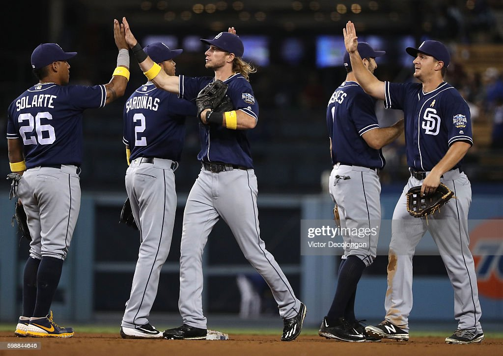 Yangervis Solarte #26 and Travis Jankowski #16 of the San Diego Padres and teammates celebrate with high fives after their 4-2 win in their MLB game against the Los Angeles Dodgers at Dodger Stadium on September 2, 2016 in Los Angeles, California.