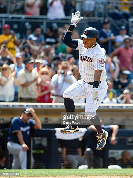Yangervis Solarte of the San Diego Padres celebrates after hitting a tworun home run during the sixth inning of a baseball game against the Milwaukee...