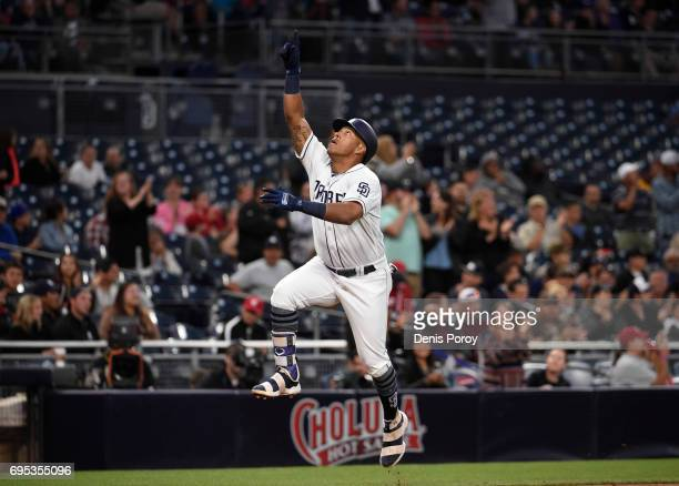 Yangervis Solarte of the San Diego Padres celebrates after hitting a solo home run during the second inning of a baseball game against the Cincinnati...