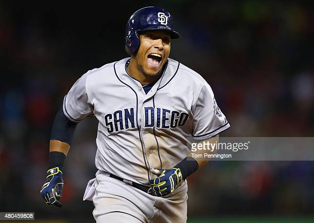 Yangervis Solarte of the San Diego Padres celebrates hitting the game winningtwo run home run against the Texas Rangers in the top of the ninth...