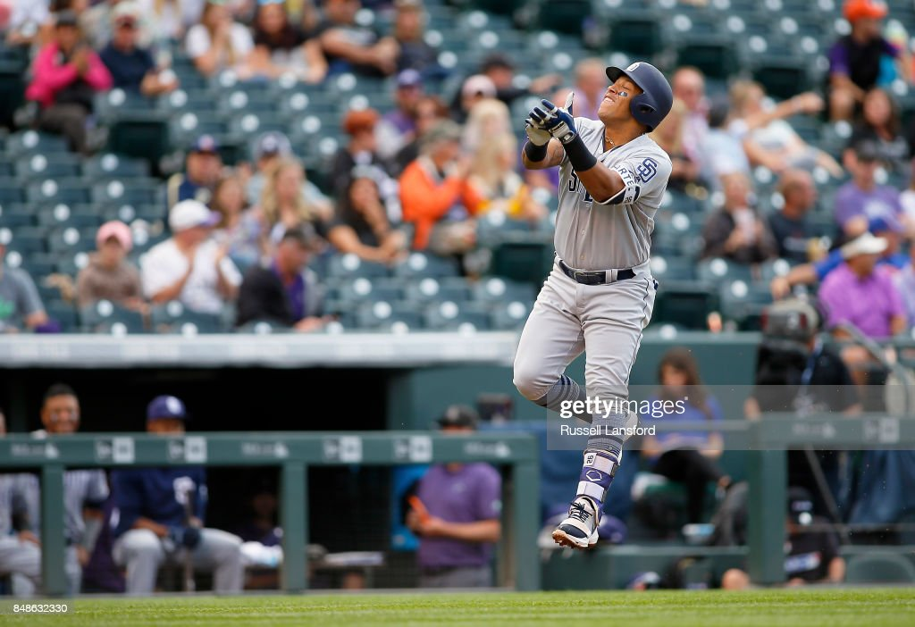 Yangervis Solarte #26 of the San Diego Padres celebrates on his way to the plate following a solo homerun in the sixth inning of a regular season MLB game between the Colorado Rockies and the visiting San Diego Padres at Coors Field on September 17, 2017 in Denver, Colorado.