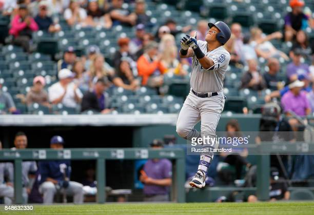 Yangervis Solarte of the San Diego Padres celebrates on his way to the plate following a solo homerun in the sixth inning of a regular season MLB...