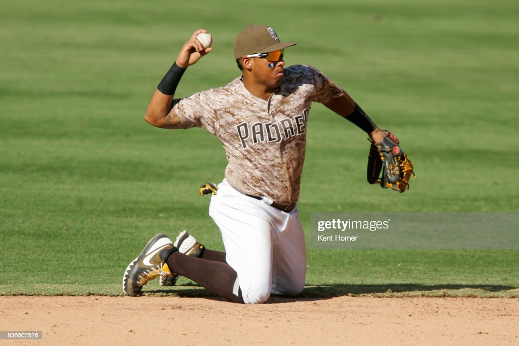 Yangervis Solarte #26 of the San Diego Padres fields the ball during the ninth inning against the Washington Nationals at PETCO Park on August 20, 2017 in San Diego, California.