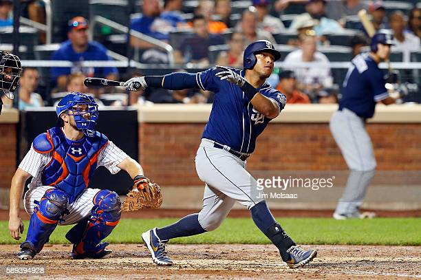 Yangervis Solarte of the San Diego Padres follows through on a seventh inning home run against the New York Mets at Citi Field on August 13 2016 in...