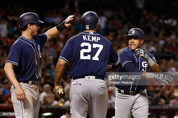 Yangervis Solarte of the San Diego Padres highfives Wil Myers and Matt Kemp after Solarte hit a threerun home run against the Arizona Diamondbacks...