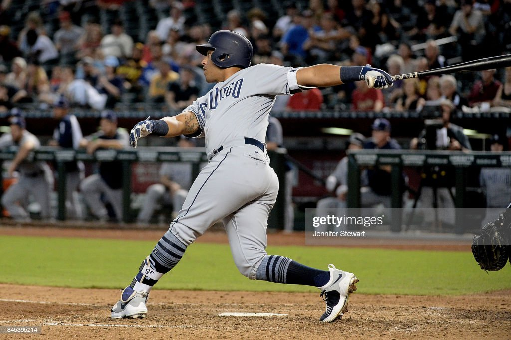 Yangervis Solarte #26 of the San Diego Padres hits a sacrifice fly in the sixth inning of the MLB game against the Arizona Diamondbacks at Chase Field on September 10, 2017 in Phoenix, Arizona.