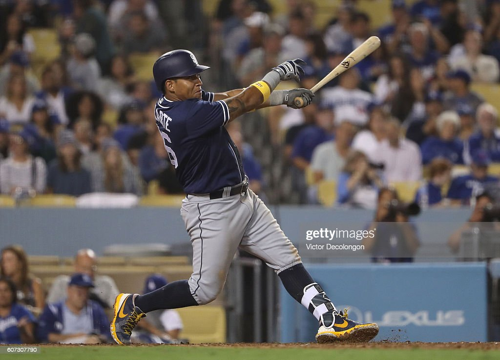 Yangervis Solarte #26 of the San Diego Padres hits a solo homerun to center field during the eighth inning of their MLB game against the Los Angeles Dodgers at Dodger Stadium on September 2, 2016 in Los Angeles, California. The Padres defeated the Dodgers 4-2.