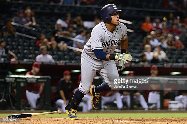 Yangervis Solarte of the San Diego Padres hits a two run home run during the ninth inning against the Arizona Diamondbacks at Chase Field on July 6...