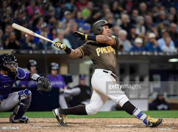 Yangervis Solarte of the San Diego Padres hits a tworun home run during the fifth inning of a baseball game against the Colorado Rockies at PETCO...