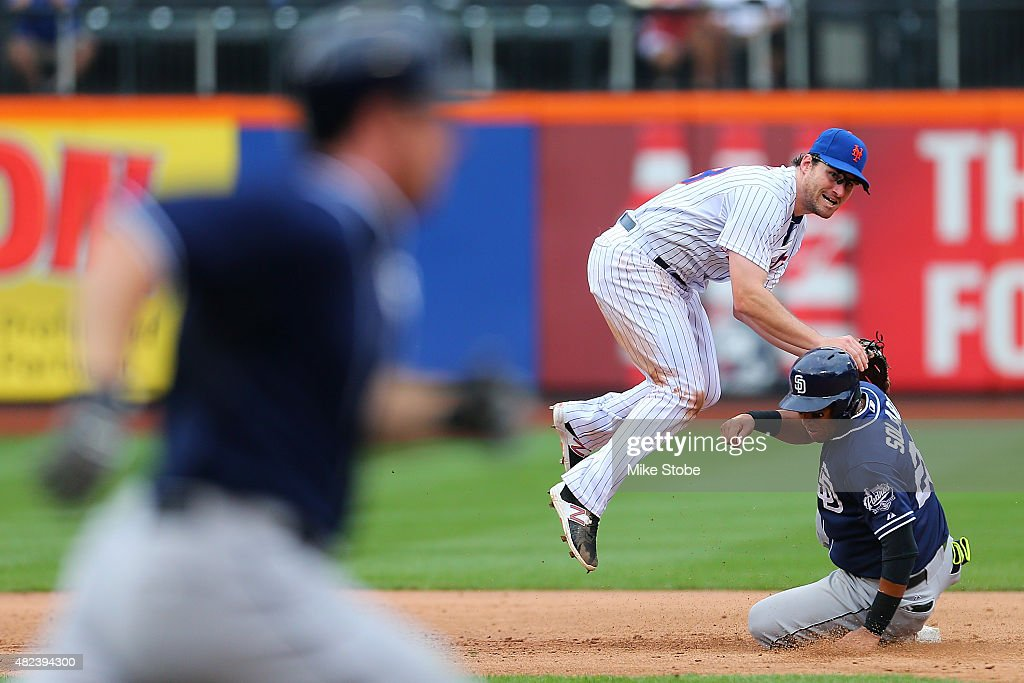 Yangervis Solarte #26 of the San Diego Padres is forced out a second as Daniel Murphy #28 of the New York Mets completes the double play in the sixth inning at Citi Field on July 30, 2015 in Flushing neighborhood of the Queens borough of New York City.