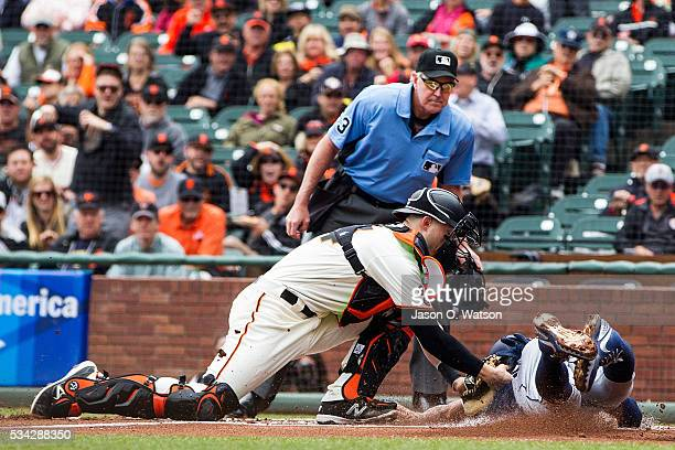 Yangervis Solarte of the San Diego Padres is tagged out at home plate by Trevor Brown of the San Francisco Giants in front of umpire Mike Winters...