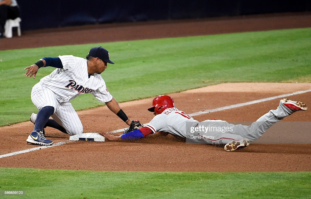 Yangervis Solarte #26 of the San Diego Padres out Cesar Hernandez #16 of the Philadelphia Phillies as he tries to steal third base during the seventh inning of a baseball game at PETCO Park on August 6, 2016 in San Diego, California.