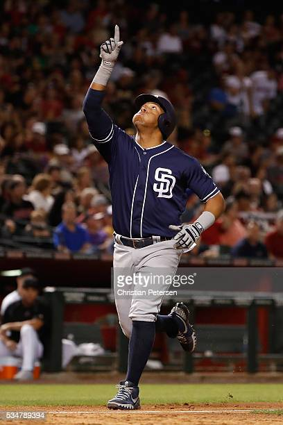 Yangervis Solarte of the San Diego Padres reacts as he crosses home plate after hitting a solo home run against the Arizona Diamondbacks during the...