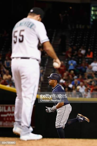 Yangervis Solarte of the San Diego Padres rounds the bases after hitting a threerun home run against relief pitcher Josh Collmenter of the Arizona...
