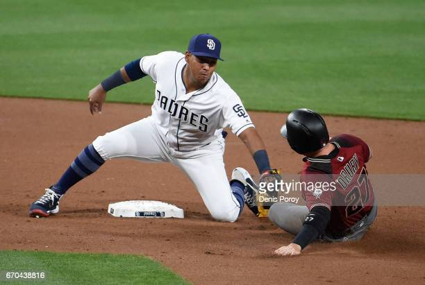 Yangervis Solarte of the San Diego Padres tags out Brandon Drury of the Arizona Diamondbacks as he tries to steal second base during the second...