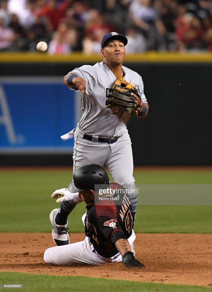 Yangervis Solarte #26 of the San Diego Padres turns a double play as Ketel Marte #4 of the Arizona Diamondbacks slides into second base during the eighth inning at Chase Field on September 9, 2017 in Phoenix, Arizona. Padres won 8-7.