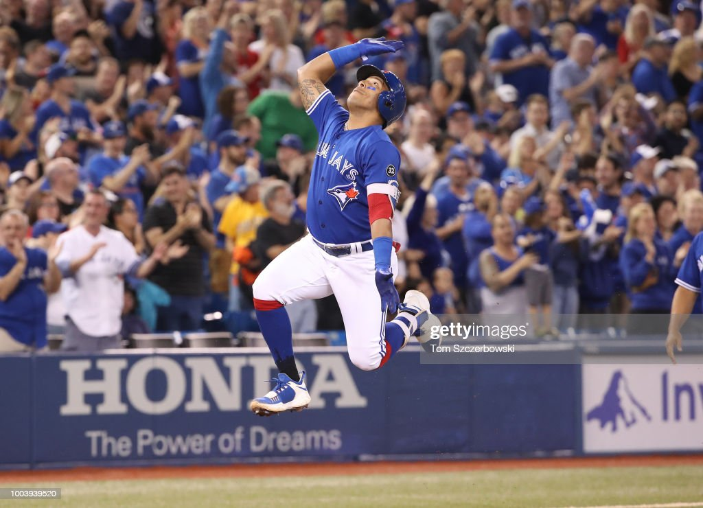 Yangervis Solarte #26 of the Toronto Blue Jays celebrates after hitting a two-run home run in the eighth inning during MLB game action against the Baltimore Orioles at Rogers Centre on July 22, 2018 in Toronto, Canada.