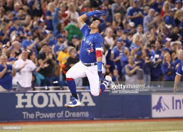 Yangervis Solarte of the Toronto Blue Jays celebrates after hitting a tworun home run in the eighth inning during MLB game action against the...