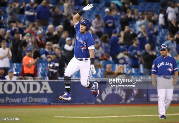 Yangervis Solarte of the Toronto Blue Jays celebrates after hitting a tworun home run in the first inning during MLB game action against the Kansas...