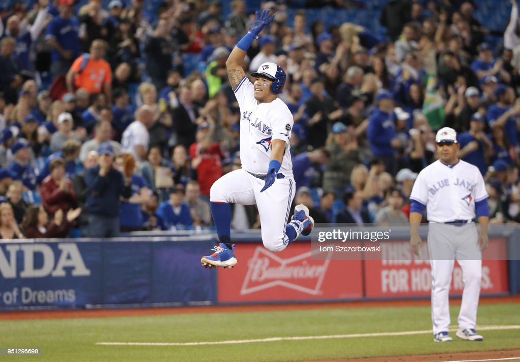 Yangervis Solarte #26 of the Toronto Blue Jays celebrates after hitting a solo home run in the sixth inning during MLB game action against the Boston Red Sox at Rogers Centre on April 25, 2018 in Toronto, Canada.