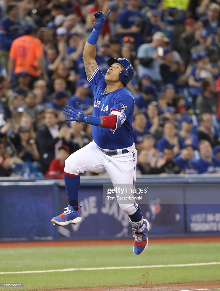 Yangervis Solarte #26 of the Toronto Blue Jays celebrates after hitting a solo home run in the second inning during MLB game action against the Texas Rangers at Rogers Centre on April 29, 2018 in Toronto, Canada.