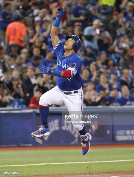 Yangervis Solarte of the Toronto Blue Jays celebrates after hitting a solo home run in the second inning during MLB game action against the Texas...