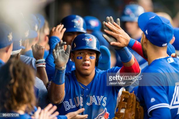 Yangervis Solarte of the Toronto Blue Jays celebrates after hitting a grand slam during the eleventh inning off Tyler Olson of the Cleveland Indians...