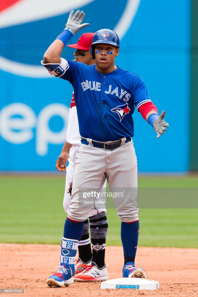 Yangervis Solarte #26 of the Toronto Blue Jays celebrates after hitting a double during the third inning against the Cleveland Indians at Progressive Field on May 3, 2018 in Cleveland, Ohio. All players are wearing #42 in honor of Jackie Robinson Day in this makeup game from April 15.