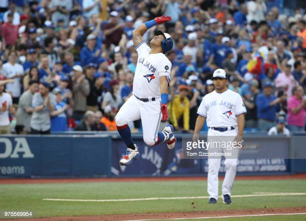 Yangervis Solarte of the Toronto Blue Jays celebrates after hitting a solo home run in the third inning during MLB game action against the Washington...