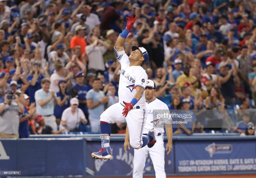 Yangervis Solarte #26 of the Toronto Blue Jays celebrates after hitting a two-run home run in the seventh inning during MLB game action against the New York Mets at Rogers Centre on July 3, 2018 in Toronto, Canada.