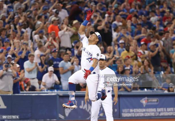 Yangervis Solarte of the Toronto Blue Jays celebrates after hitting a tworun home run in the seventh inning during MLB game action against the New...