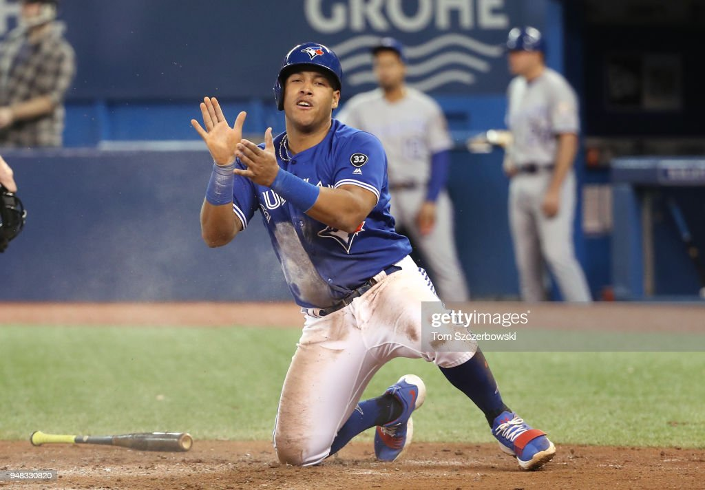Yangervis Solarte #26 of the Toronto Blue Jays celebrates after sliding across home plate scoring a run in the fifth inning during MLB game action against the Kansas City Royals at Rogers Centre on April 18, 2018 in Toronto, Canada.