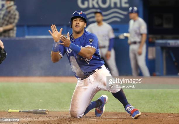 Yangervis Solarte of the Toronto Blue Jays celebrates after sliding across home plate scoring a run in the fifth inning during MLB game action...