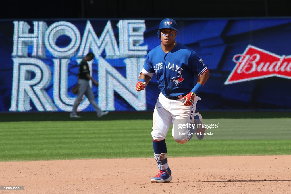 Yangervis Solarte #26 of the Toronto Blue Jays circles the bases after hitting a two-run home run in the ninth inning during MLB game action against the Oakland Athletics at Rogers Centre on May 20, 2018 in Toronto, Canada.