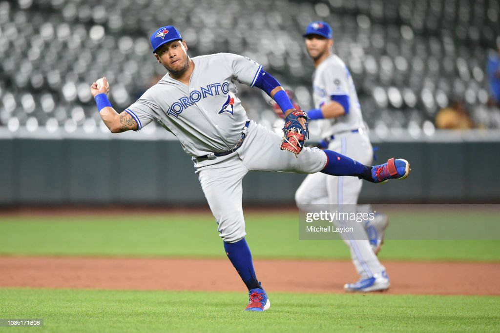 Yangervis Solarte #26 of the Toronto Blue Jays fields a a ground ball hit by Trey Mancini #16 (not pictured) of the Baltimore Orioles in the fourth inning during a baseball game at Oriole Park at Camden Yards on September 17, 2018 in Baltimore, Maryland.