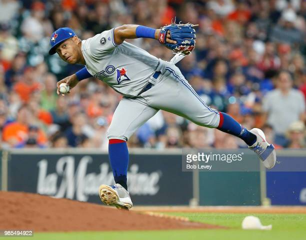 Yangervis Solarte of the Toronto Blue Jays fields a slow rolling ground ball off the bat of Jose Altuve of the Houston Astros in the seventh inning...