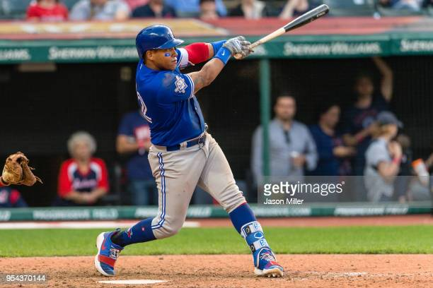 Yangervis Solarte of the Toronto Blue Jays hits a grand slam during the eleventh inning off Tyler Olson of the Cleveland Indians at Progressive Field...