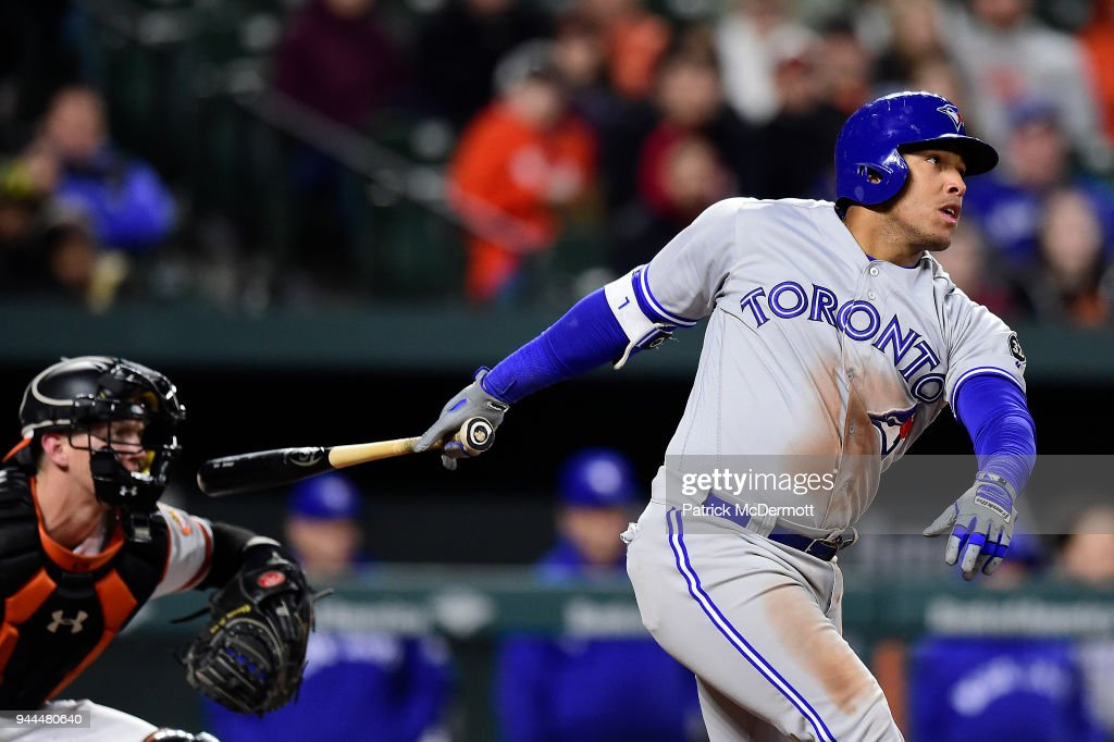 Yangervis Solarte #26 of the Toronto Blue Jays hits a single and Justin Smoak #14 (not pictured) scored on the play in the eighth inning against the Baltimore Orioles at Oriole Park at Camden Yards on April 10, 2018 in Baltimore, Maryland.