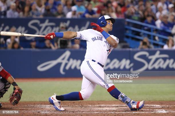 Yangervis Solarte of the Toronto Blue Jays hits a tworun home run in the seventh inning during MLB game action against the Washington Nationals at...