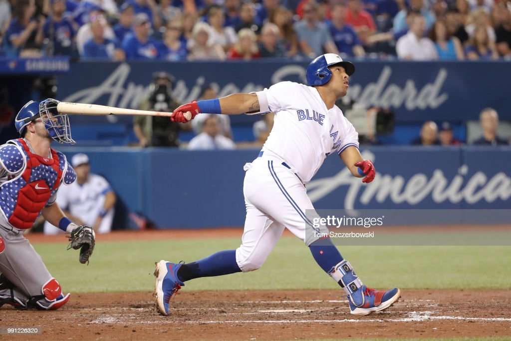 Yangervis Solarte #26 of the Toronto Blue Jays hits a two-run home run in the seventh inning during MLB game action against the New York Mets at Rogers Centre on July 3, 2018 in Toronto, Canada.