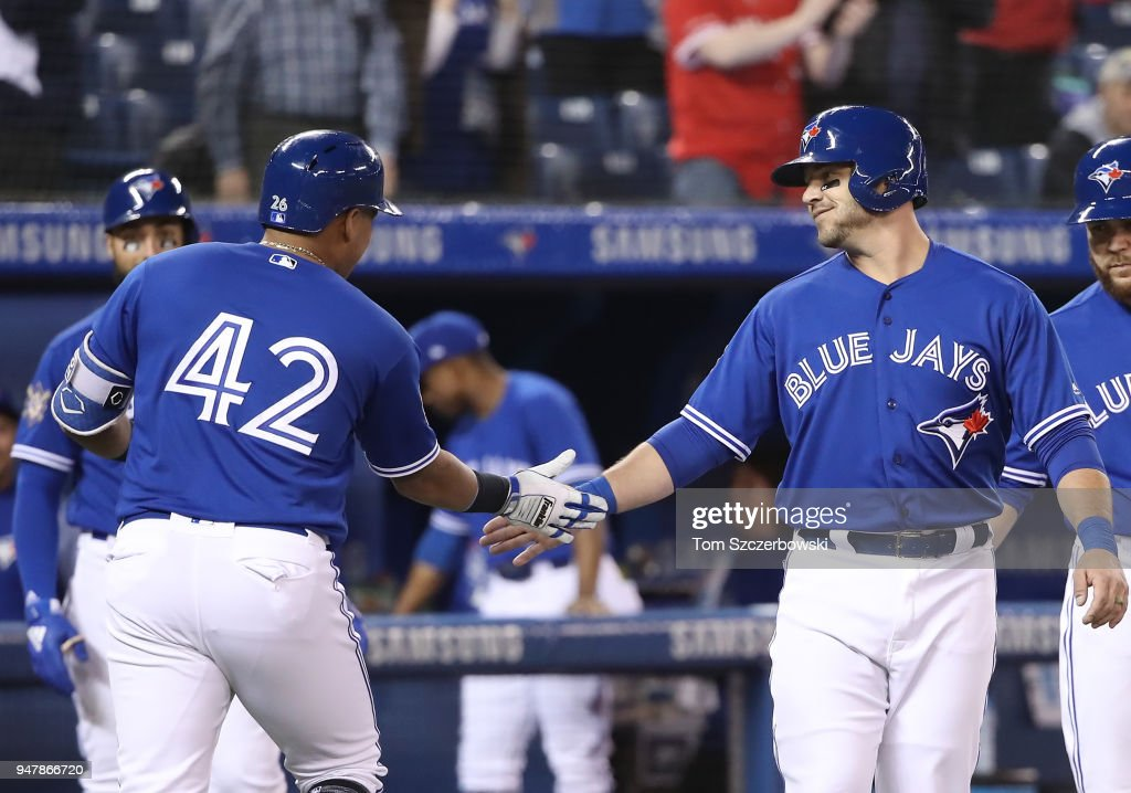 Yangervis Solarte #26 of the Toronto Blue Jays is congratulated by Steve Pearce #28 after hitting a two-run home run in the first inning during MLB game action against the Kansas City Royals at Rogers Centre on April 17, 2018 in Toronto, Canada.