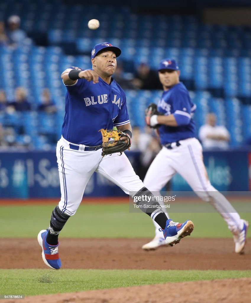 Yangervis Solarte #26 of the Toronto Blue Jays makes the play and throws out the baserunner in the sixth inning during MLB game action against the Kansas City Royals at Rogers Centre on April 17, 2018 in Toronto, Canada.