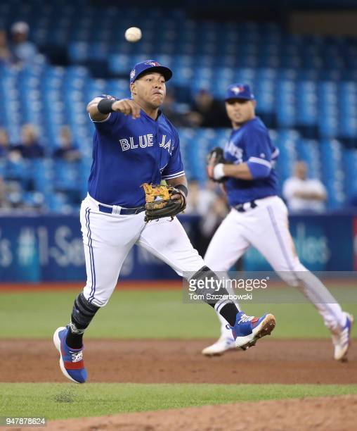 Yangervis Solarte of the Toronto Blue Jays makes the play and throws out the baserunner in the sixth inning during MLB game action against the Kansas...