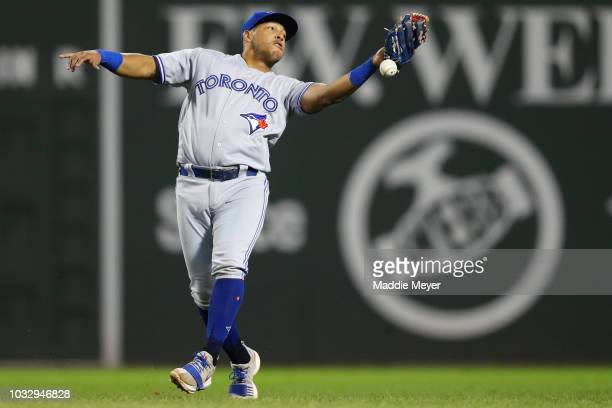 Yangervis Solarte of the Toronto Blue Jays mishandles a pop fly from Blake Swihart of the Boston Red Sox committing an error during the eighth inning...
