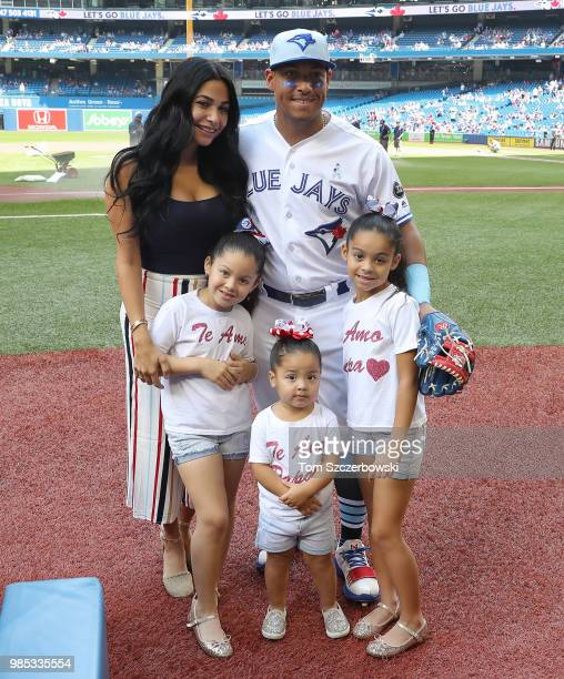 Yangervis Solarte of the Toronto Blue Jays poses with his wife and his daughters on Fathers Day before the start of MLB game action against the...