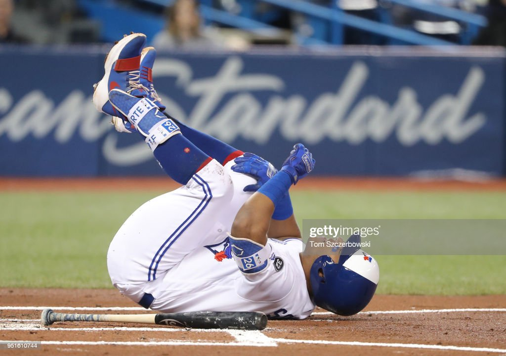 Yangervis Solarte #26 of the Toronto Blue Jays reacts after being hit by pitch in the first inning during MLB game action against the Boston Red Sox at Rogers Centre on April 26, 2018 in Toronto, Canada.