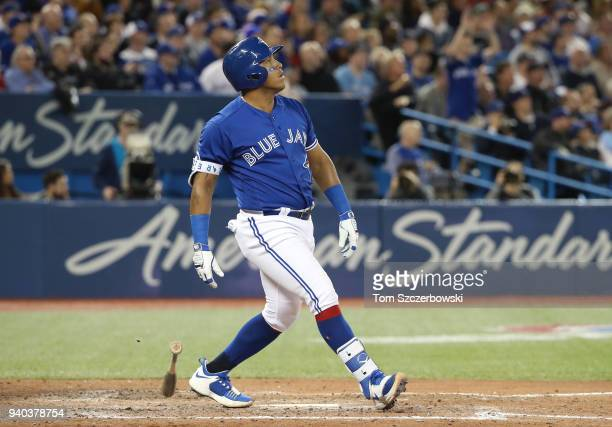 Yangervis Solarte of the Toronto Blue Jays reacts as he hits a solo home run in the eighth inning during MLB game action against the New York Yankees...